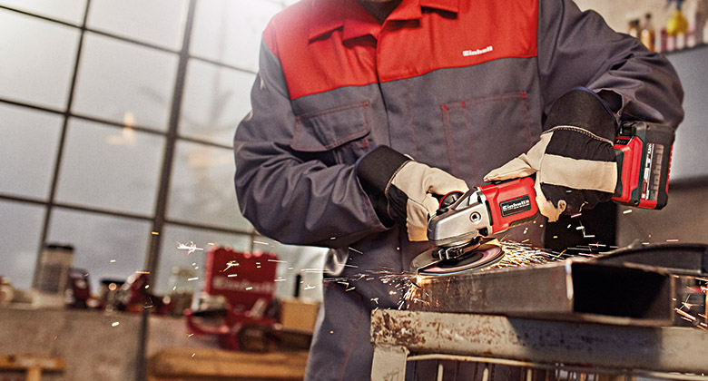 man uses angle grinder from Einhell