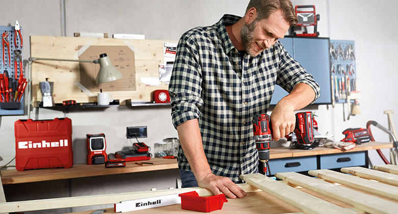 man uses cordless drill driver from Einhell