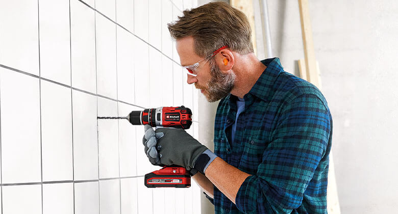man uses cordless impact driver from