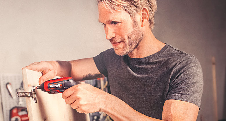 man uses cordless screwdriver from Einhell
