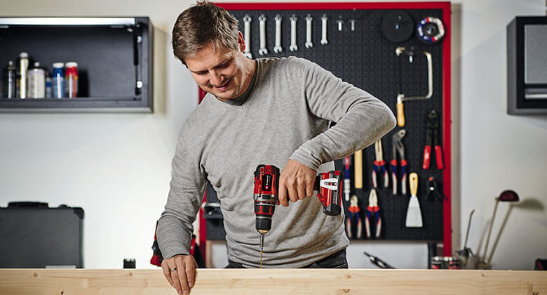 man with a Power X-Change cordless screwdriver from Einhell