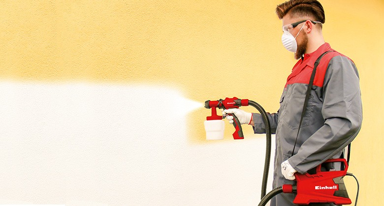 painting wall with paint spray system from Einhell