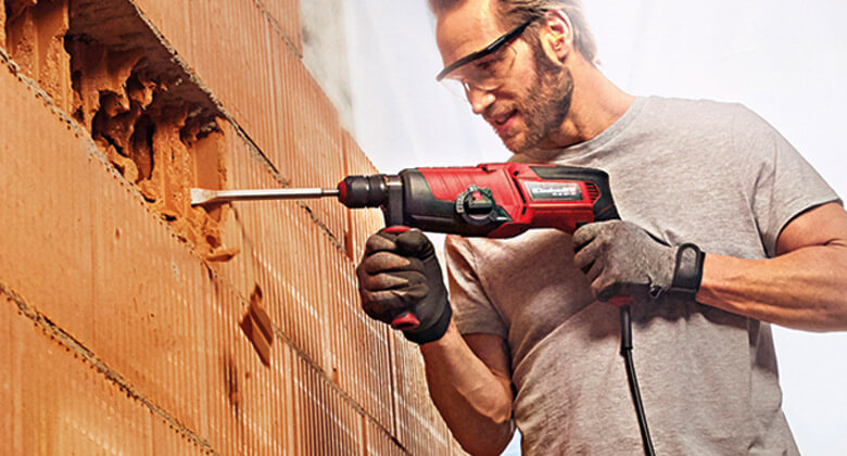 man uses rotary hammer drill from Einhell