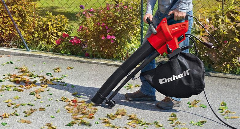man works with electric leaf vacuum from Einhell