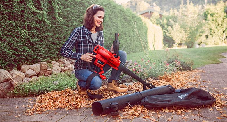 woman with cordless Einhell leaf vacuum