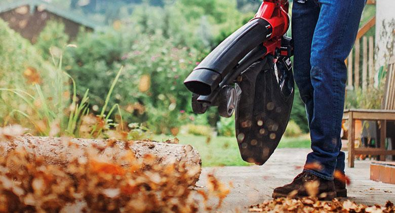 man uses cordless leaf vacuum from Einhell